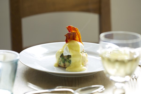 Bubble and squeak with oak-smoked streaky bacon, a poached hen's egg and hollandaise sauce