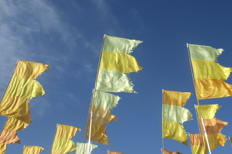 yellow flags against blue skies, Glastonbury